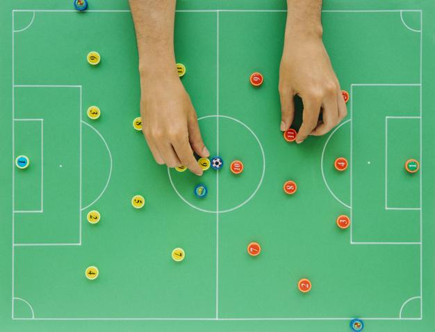 sfondo di calcio con il concetto di tattiche e le mani 23 2147832059 - Le regole del Fantacalcio